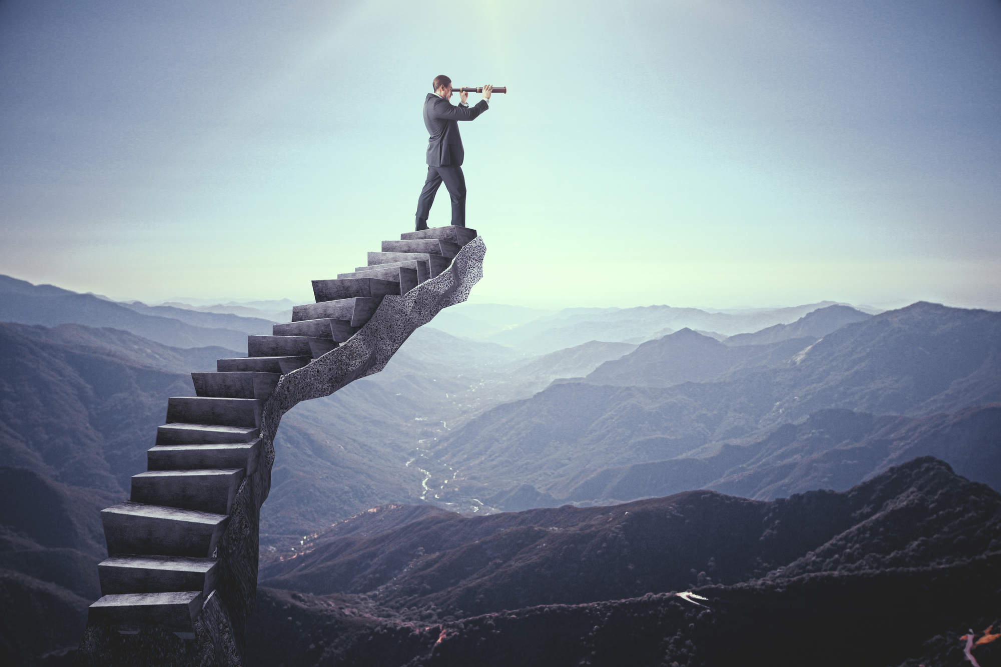Businessman looking into the distance on abstract stairs. Landscape background. Research and vision